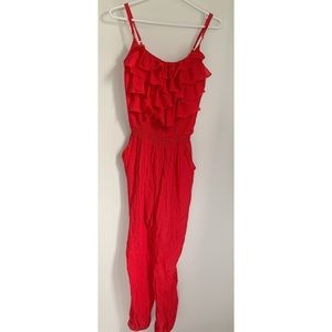 Magazine red jumpsuit with ruffle decoration